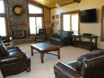 Great Room - Plenty of seating, fireplace, chess table and 46' TV