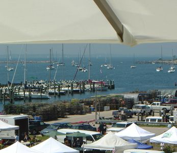 close-up view from deck of farmers market, fishing pier and harbor