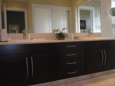 The Second Master Suite Bath Offers Dual Sinks, Travertine Countertops And A....