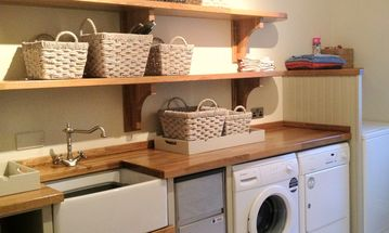 Utility room with double fridge, ice machine, washing facilities etc..