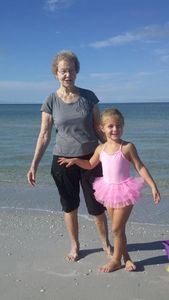 Brad's Mom with our granddaughter Sydney at the beach