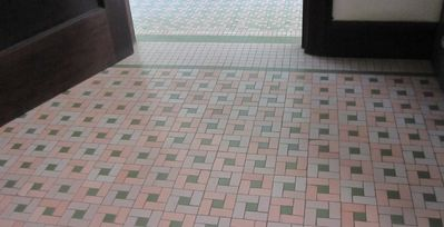 Original antique mosaic pattern floors throughout the apartment.