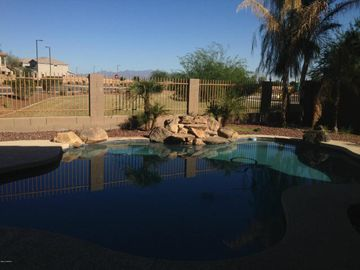 Buckeye house rental - Refreshing pool with park in the background