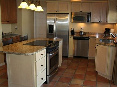 Kitchen Area W/ Granite Countertops, Stainless Appliances, Electrolux Oven