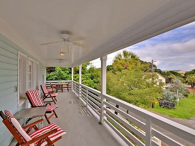Catch the ocean breeze on the expansive front porch.