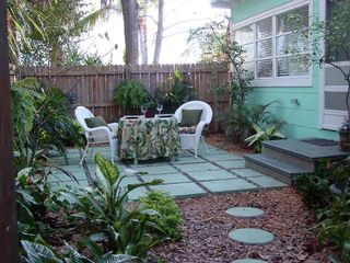 Gulfport cottage photo - Entrance with beautiful landscaped gardens and brick walkways.