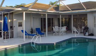 East Naples house photo - Pool and Lanai Dining adjacent to the livingroom and kitchen areas.