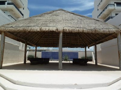 Cancun condo rental - Complex's seating area, smoking area.