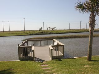 North Padre Island condo photo - Pier and salt water pond on property