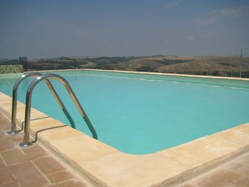 Pool side view over Tuscany