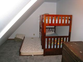 Upstairs Bedroom / Bunk bed with Trendle, and single bed. Sleeps 4