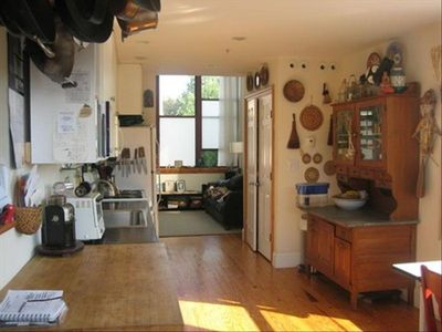 Kitchen, dining room, looking into living room.