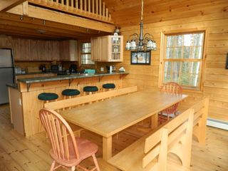 Carrabassett Valley house photo - Dining area with extra seating at the bar.