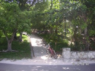 Elbow Cay and Hope Town villa photo - Golf cart ramp up to the Wynne Rae overlooking the ocean.