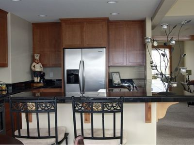 Fully stocked gourmet kitchen. Enjoy the view while preparing meals.