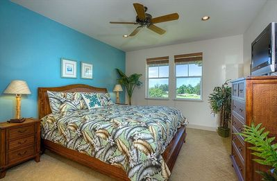 Master bedroom has a California King bed and a stunning view of the golf course