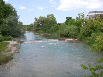 Elk Rapids River where plenty of people enjoy swimming in the rapids.
