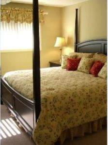 King bed in the beautifully furnished master bedroom.