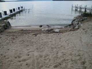 Small sandy beach with 40 foot dock on the right. - Alton house vacation rental photo