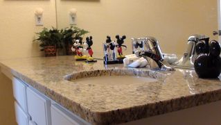 Windsor Hills condo photo - Mickey themed with granite countertops in the second bathroom