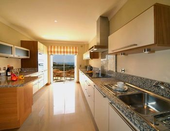 Kitchen leading to Balcony with Sea Views