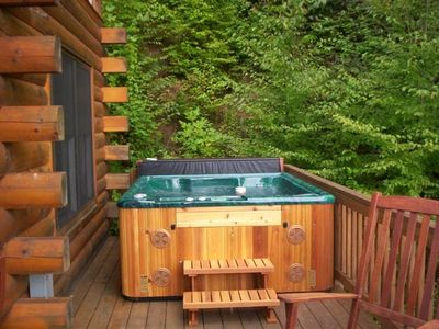 Soak in the hot tub overlooking spectacular views