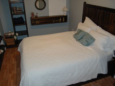 The private master bedroom has a queensize bed, and lots of open storage.