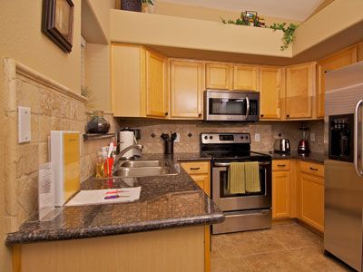 The Fully-Equipped Kitchen has Stainless-Steel Appliances & Granite Countertops.
