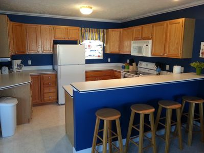 Open kitchen, views of marina! Breakfast bar with stools