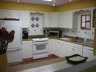Shipyard villa photo - Large kitchen complete with new stove, fridge, dishwasher, Kerig and skylights
