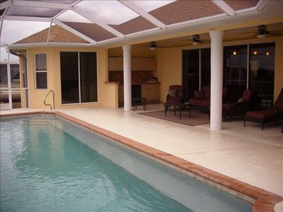 Screened in Heated Pool with Summer Kitchen