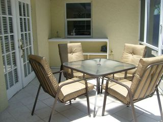 Outdoor dining and wet bar. - Siesta Key house vacation rental photo