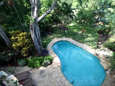 Lush tropical plants and rock waterfall invite you to enjoy the private pool