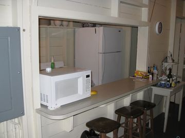 This is looking into the kitchen, which is equipped with everything you need.