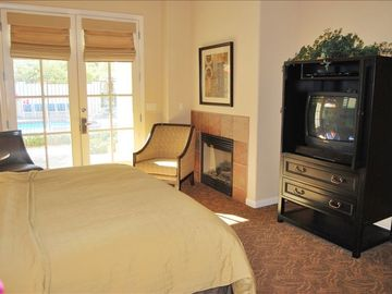 Master suite with King bed, patio, fireplace, butlers pantry and private bath.
