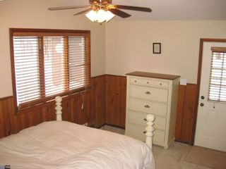 Master bedroom with queen pillow top bed