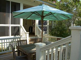 Port St. Joe house photo - Two outdoor dining decks ~ Parents can savor dinner while kids race off to play!