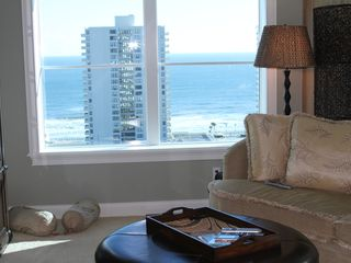 Daytona Beach Shores condo photo - One of the living room windows looking up and down the beach with panoramic view