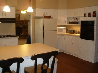 Kitchen Features Dishwasher, Coffee Maker, Microwave, Stove, Oven, Refrigerator