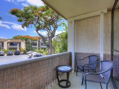 Covered lanai with large sitting area and ocean views