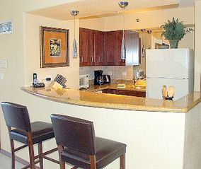 Kahana condo photo - Kitchen: granite countertops, premium cabinets, pendant lighting.
