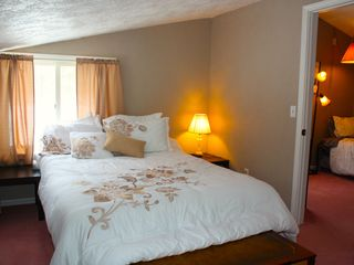 Crystal Mountain, Thompsonville lodge photo - Upstairs bedroom side A with comfy queen bed and fluffy pillows.