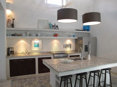 Gourmet kitchen with custom granite counters.
