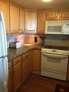 Beautiful Granite Kitchen with ceramic top stove