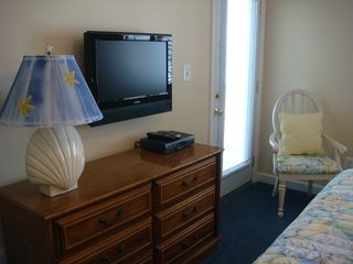 Surfside Beach condo photo - Master bedroom with flat screen TV and balcony access