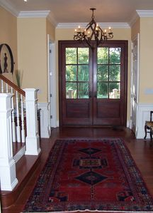 Front hall with coat closet and one of two laundry rooms