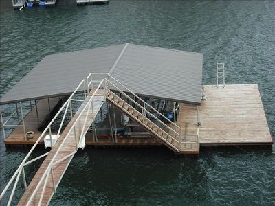 Large 2 slip boat dock with swim platform. One hydralift  to keep your boat up.