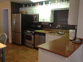 Mexico Beach house photo - Updated kitchen with quartz counter tops and stainless steel appliances.