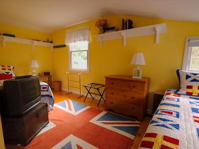 Twin bedroom with windows towards woods, pond; a/c