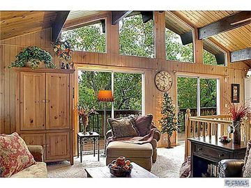 Moonridge cabin rental - Large windows to the balcony, overlooking the beautiful trees in backyard